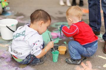 ASTANA, KAZAKHSTAN - SEPTEMBER 08, 2013: Astana central park children festival of ground paintings on September 08, 2013 in Astana, Kazakhstan. Children painting on the ground.
