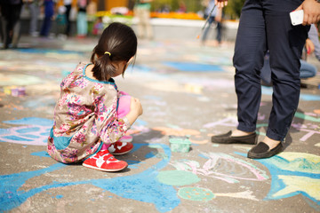 ASTANA, KAZAKHSTAN - SEPTEMBER 08, 2013: Astana central park children festival of ground paintings on September 08, 2013 in Astana, Kazakhstan. Children painting on the ground.