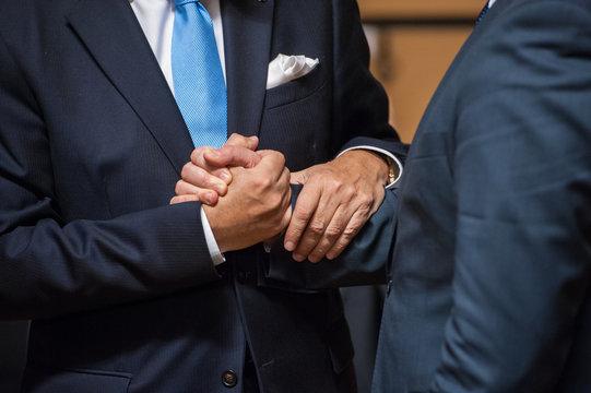 Ministers shake hand
