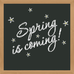 """Spring is coming!"" inscription in chalk on a blackboard. Signbo"
