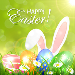Green background with colored Easter eggs and rabbit
