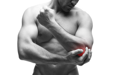 Pain in the elbow. Muscular male body. Handsome bodybuilder posing in studio. Isolated on white background with red dot