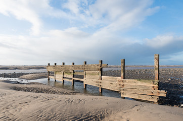 cleveleys, england, 02/17/2016, A rustic, weathered wooden sea defence wall, showing signs of damage...