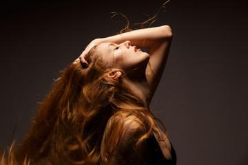 Portrait of beautiful blonde woman in a studio