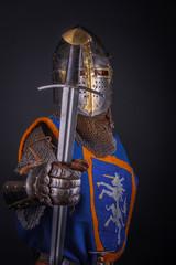 A man in kinight armour.