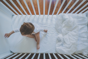 Portrait of a girl in her crib