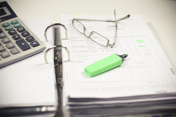 Tax form pen and glasses