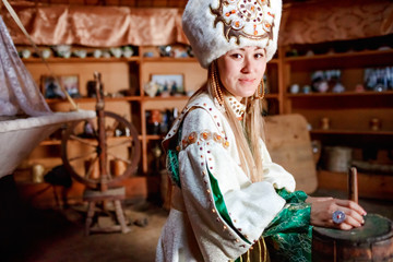 Young woman in traditional yurt dwelling.