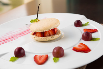 fresh strawberry and cream macaroons serves with grape and strawberry segments