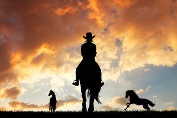 girl on horseback at sunset