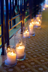 large candles in glass