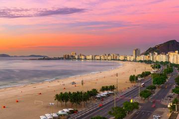 Sunrise view of Copacabana beach and Avenida Atlantica in Rio de Janeiro, Brazil