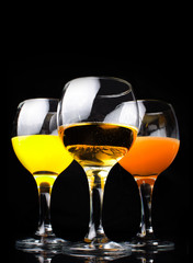 Citrus juice in a glass on a black background