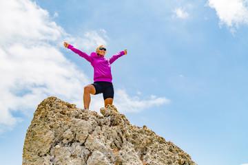 Happy trail runner winner reaching life goal success woman