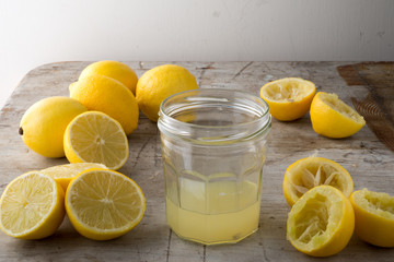 A Jar of Lemon Juice with Lemons