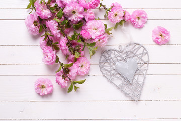 Pink   flowers  and grey  decorative heart on white  painted woo