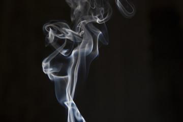 White smoke on isolated dark background