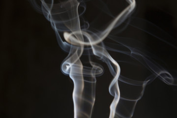 White smoke on isolated dark background