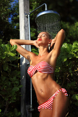 Sexy blonde taking a shower