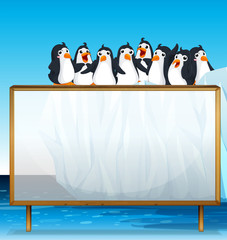 Wooden frame with penguins on ice