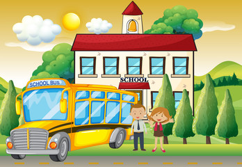 Teachers and school bus at the school