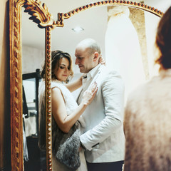 reflection gentle romantic bride and groom holding each other
