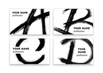 Business cards with abstract black paint smears