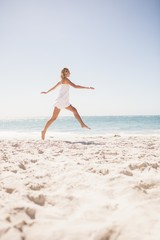 Pretty blonde woman jumping