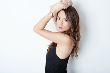 beautiful young asian woman with long hair with wrist watch