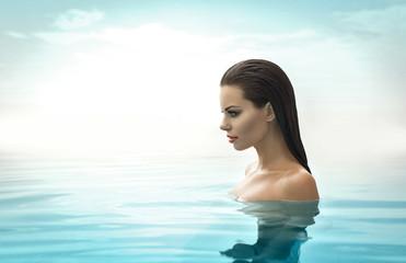 Portrait of sexy model in pool