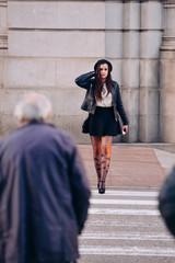 Brunette woman walking in the street