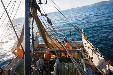 Fishermen pull trawl fish