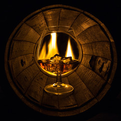 The oak barrel burning glass with cognac