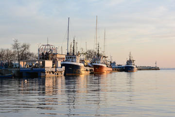 Fishing trawlers at sunset