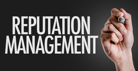 Hand writing the text: Reputation Management