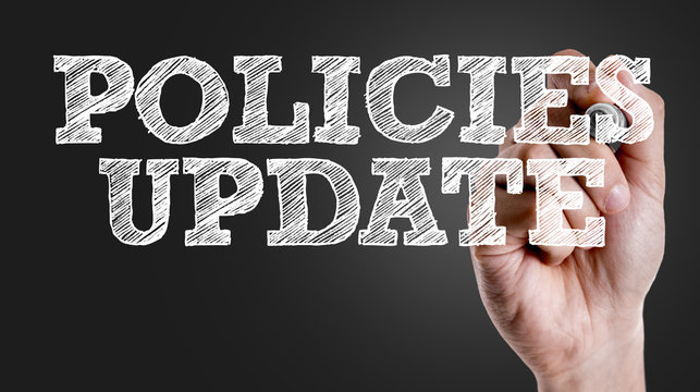 Hand writing the text: Policies Update