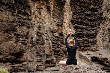 Meditation yoga session on rocks