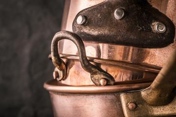 Set of copper pots and pans horizontal