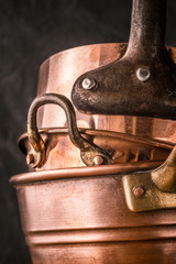 Set of copper pots and pans vertical