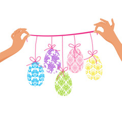 Women hands holding a cute colorful Easter Garland