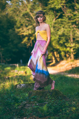Bohemian natural fashion model becoming one with nature