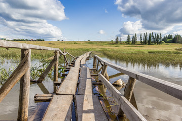 Wooden brigde over the pond