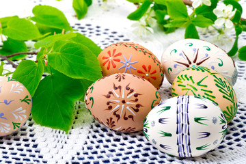 Painted Easter eggs on the white tablecloth