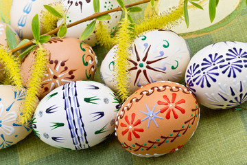 Painted Easter eggs on the green tablecloth