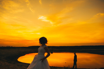 wedding couple on the background of sunset