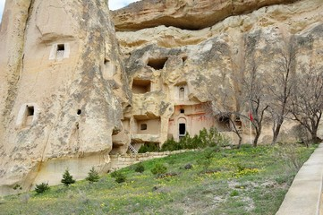First dwellings of hermits-Christians in Cappadocia. Turkey / Visible of the hermitages in the rocks. The region of Cappadocia, also famous for the unusual rock landscapes.