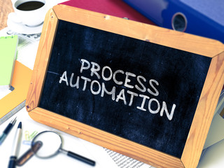 Process Automation Handwritten by White Chalk on a Blackboard. Composition with Small Chalkboard on Background of Working Table with Office Folders, Stationery, Reports. Blurred, Toned 3d Image.