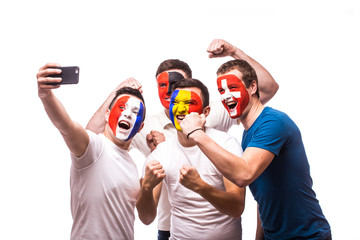 Group of football fans of their national team taking selfie photo on white background. European 2016 football fans concept.