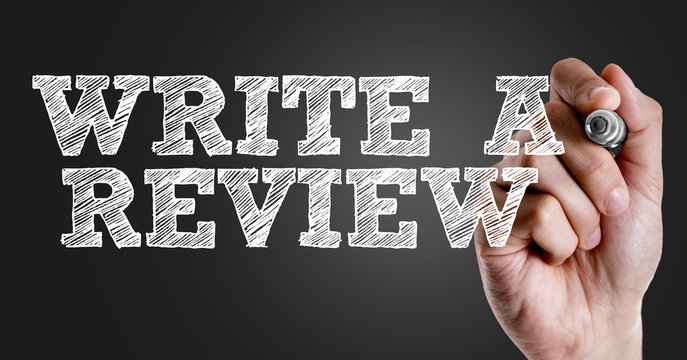 Hand writing the text: Write a Review