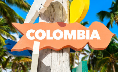 Colombia signpost with palm trees